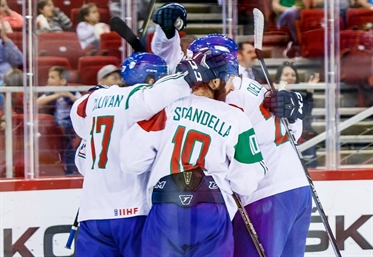Italy wins empty-net clash